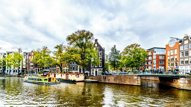 Canal Boat on the Prinsengracht in Amsterdam, the Netherlands. Canal Boat on the Prinsengracht and intersection with the Bloemgracht in the Jordaan district in stock photography