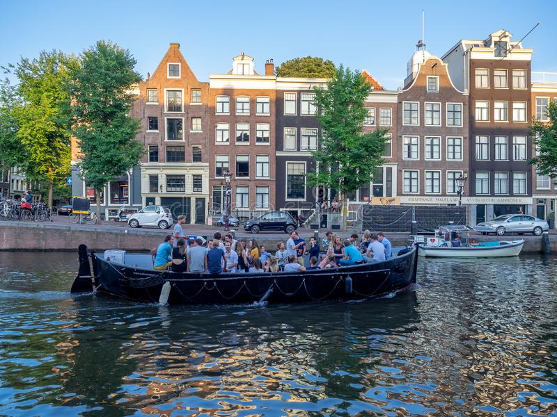 Canal boaters in Amsterdam royalty free stock photography
