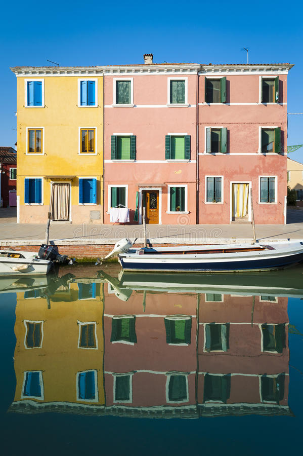 Canal, boats and reflections, Burano, Italy royalty free stock images