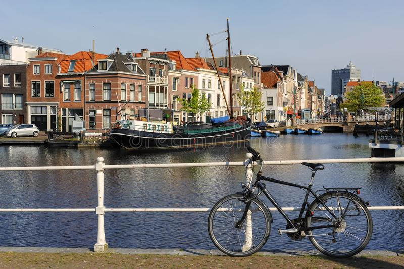 Canal with boats and typical Dutch houses in Leiden, Netherlands. royalty free stock photos