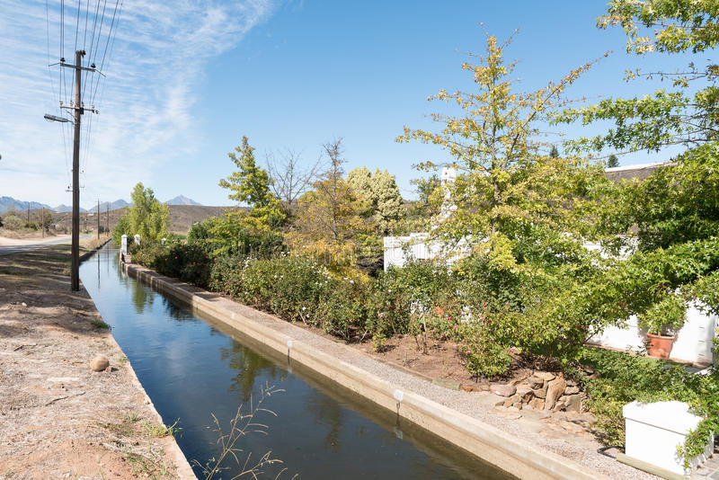 Canal in Bonnievale. BONNIEVALE, SOUTH AFRICA - MARCH 26, 2017: A canal in Bonnievale, a small town in the Western Cape Province royalty free stock images