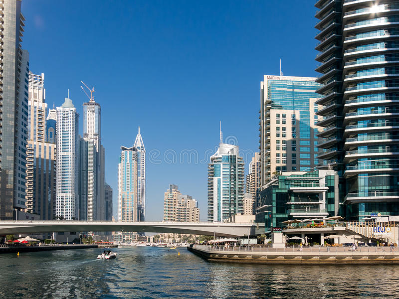 Canal and bridge in the Marina District of Dubai. Bridge, canal and Dubai Marina Walk with skyscrapers in the Marina district of Dubai, United Arab Emirates royalty free stock photos