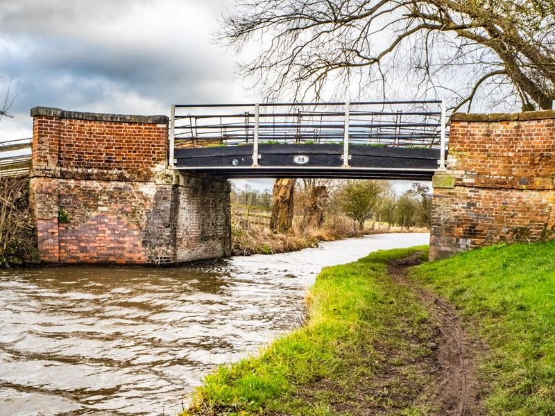 Canal bridge and canal towpath. In England royalty free stock image
