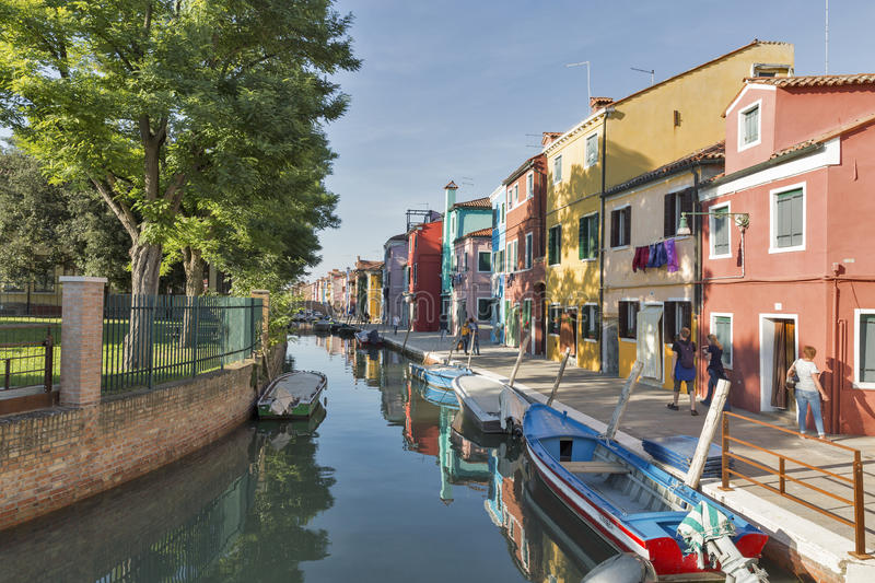 Canal with colorful houses in Burano, Italy. stock photography
