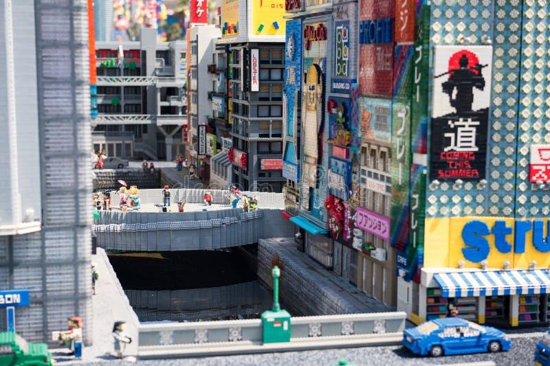 Canal de Dotonbori avec Glico dans Legoland images stock