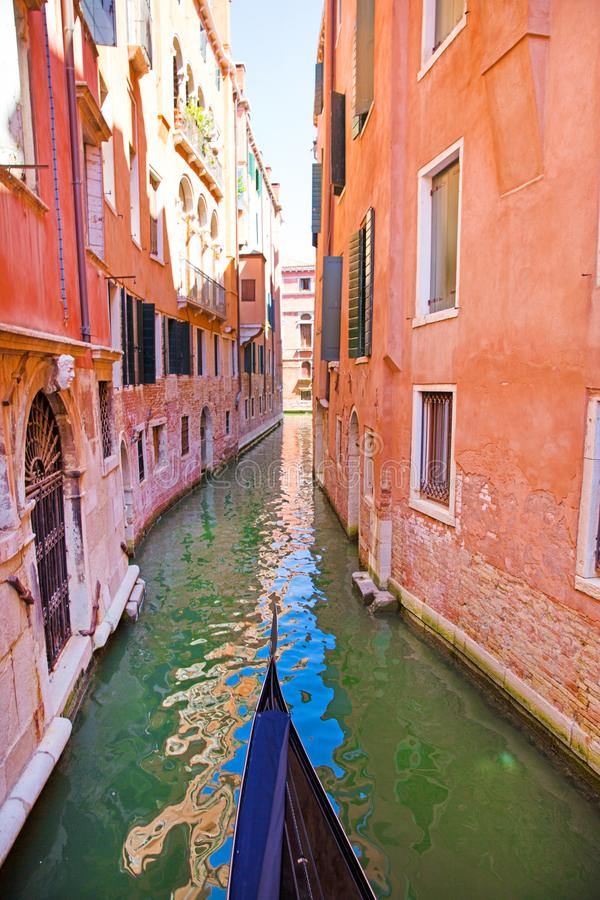 Canal and gondola in Venice, Italy. Old colorful buildings and green water. Canal and gondola in Venice, Italy. Old colorful building facades and green water stock images
