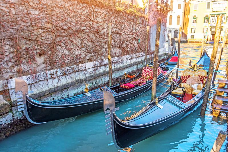 Canal with gondolas on the pier Venice, Italy. Architecture and landmarks of Venice stock images
