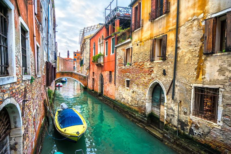 Canal with gondolas, Venice, Italy. View of an old canal with some gondolas on a sunny day, Venice, Italy stock photos