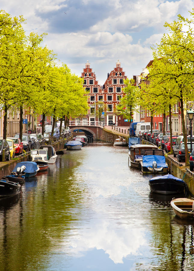 Canal of Haarlem, Netherlands. Canal with boats of Haarlem, Netherlands stock photos
