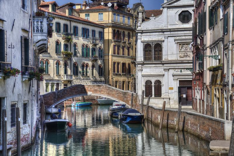 Canal and historical buildings in Venice, Italy. Canal, boats and bridge and historical buildings in Venice, Italy stock images
