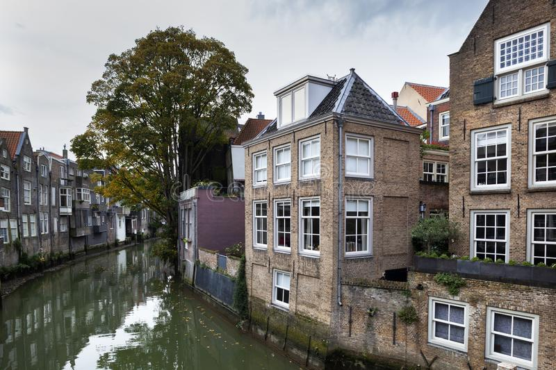 Canal houses in Dordrecht in the Netherlands. Historic canal houses along the Voorstraathaven in Dordrecht in the Netherlands stock photo