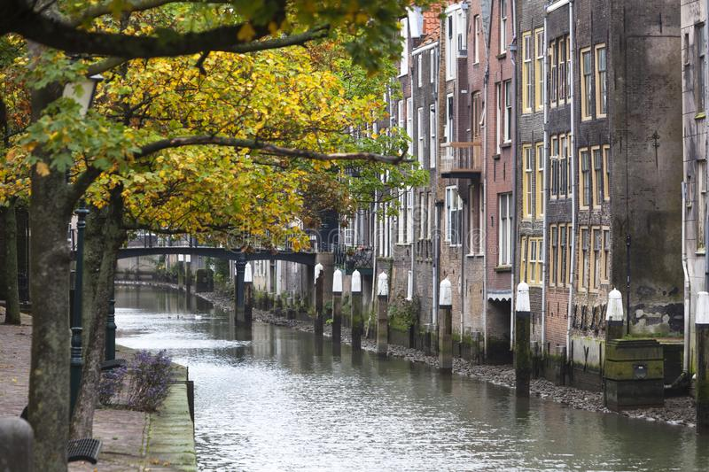 Canal houses in Dordrecht in the Netherlands. Historic canal houses along the Voorstraathaven with the bridge Pelserbrug in the background in Dordrecht in the royalty free stock image