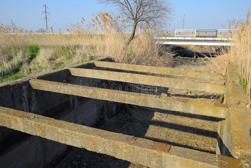 Canal irrigation system rice fields. Concrete tunnel for irrigation canal stock photos
