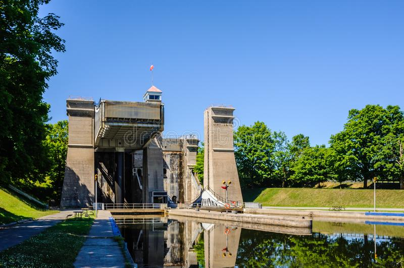 Canal and lift lock viewed from lower level in Peterborough, Ontario, Canada. PETERBOROUGH, CANADA - JUNE 21, 2018: The Peterborough Lift Lock was once the royalty free stock photo