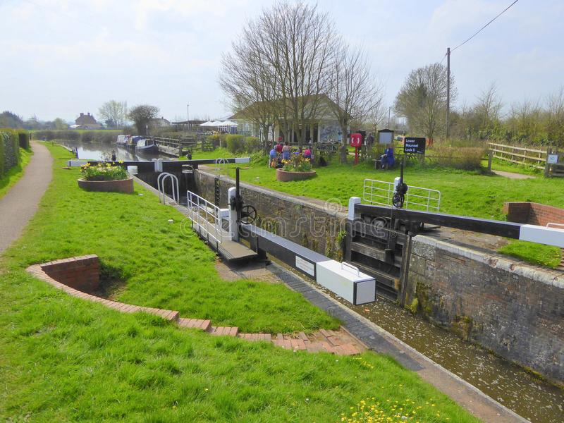 Canal lock gates and tea rooms. The canal lock gates and tearooms at Maunsel Lock on the Taunton to Bridgwater Canal in Somerset, England stock photo