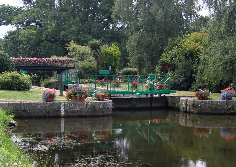 Canal Lock on the Nantes to Brest Canal. Floral Canal Lock on the Nantes to Brest Canal royalty free stock photos