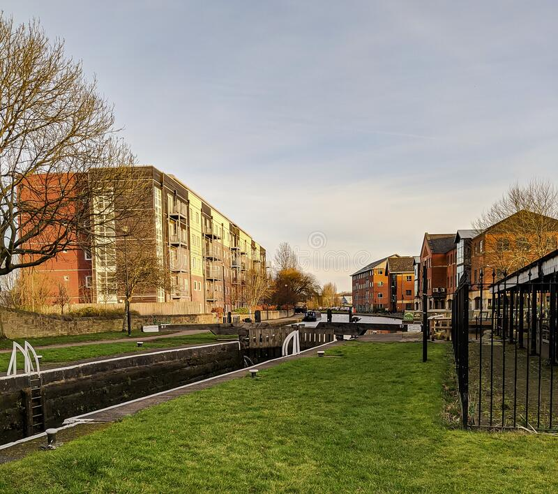 A canal lock. The wide angle shot of a canal lock in England royalty free stock images