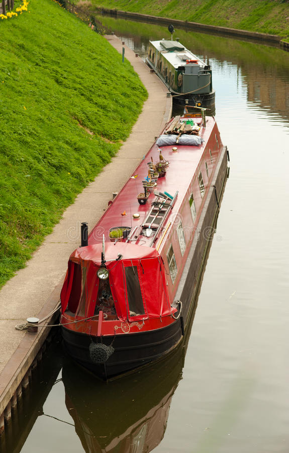 Canal and narrow boats. Narrow boats mooring on a canal in March, England royalty free stock images