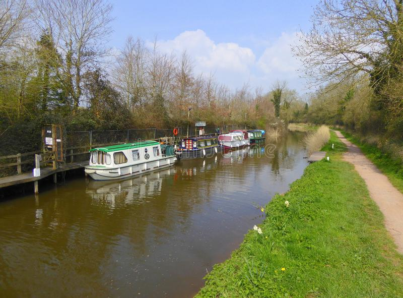 Canal narrowboats at private moorings. Narrowboats at the Somerset Navigators Boat Club private moorings at Maunsel Lock on the Taunton to Bridgwater Canal in stock photography