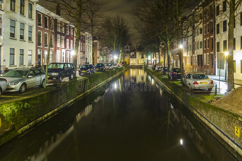 Canal at night in the Hague stock photo