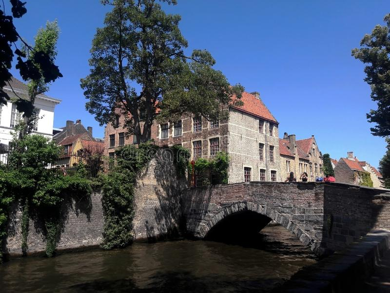 Canal in old european town, Brugge architecture stock photography