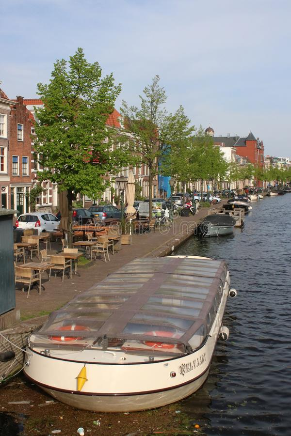 Canal and river local cruise boat, Leiden stock image
