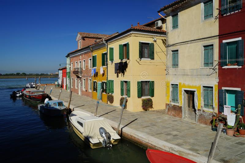 Canal and sidewalk of Burano Island, Venice, Italy royalty free stock photo