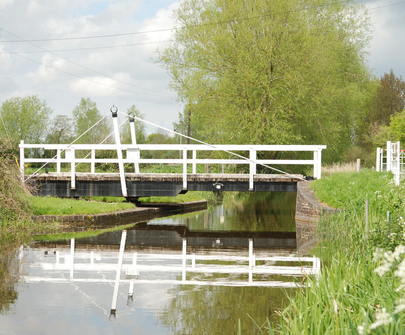 Canal Swing Bridge. Fordgate Swing bridge located on the Bridgwater and Taunton Canal in Somerset. Peaceful slow moving water that gently brakes up the royalty free stock image