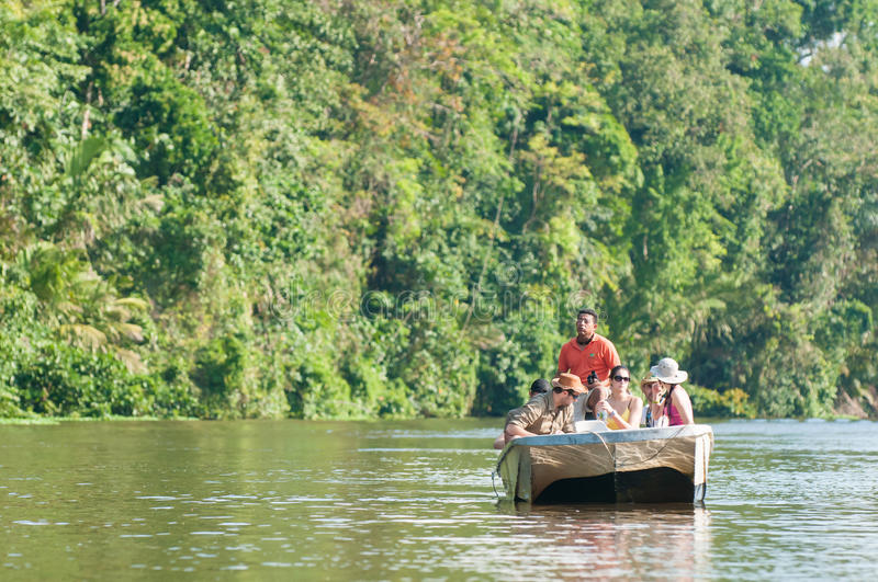 Canal touring. Tourists having guided tour in Tortuguero stock image