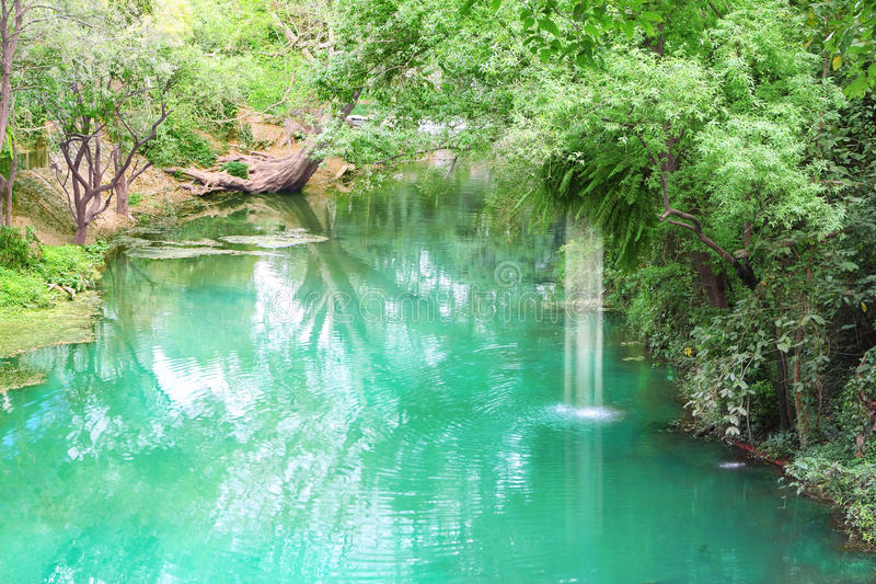 Canal in tropical forest. And small waterfall royalty free stock photography