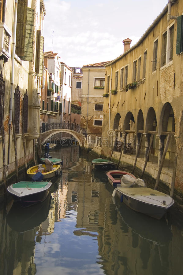 A canal in Venice. Venetian canal with boats, venice royalty free stock photo