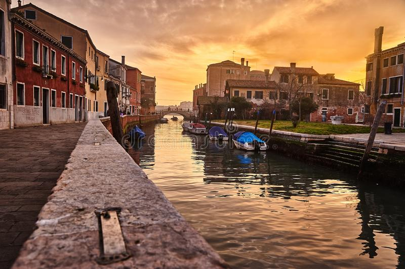 Canal in Venice, Italy, at sunset. Perspective view of a canal in Venice, Italy, at sunset stock photos