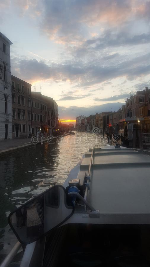 Canal in Venice at sunset. Photograph from the ship royalty free stock photography