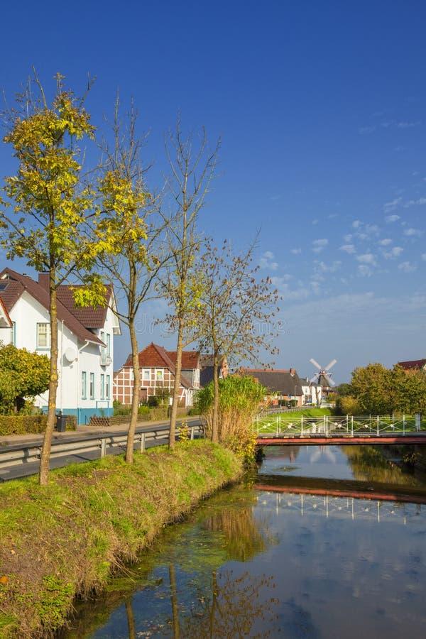Village of Jork at Altes Land region, Lower Saxony, Germany. Canal through the village of Jork, Altes Land region, Lower Saxony, Germany royalty free stock images