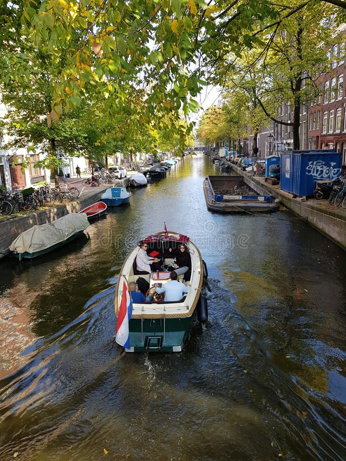 Canals of Amsterdam on an autumn day. Trees, water, river, skye, boats, tourism, transport, fun, netherlands stock photo