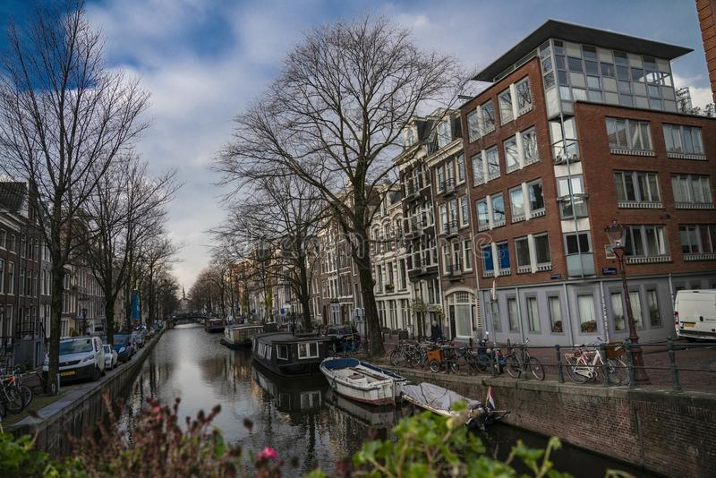 Canals of Amsterdam Holland. Amsterdam Holland The city of Amsterdam, capital of the Netherlands, is built on a network of artificial canals in Dutch: grachten stock photography