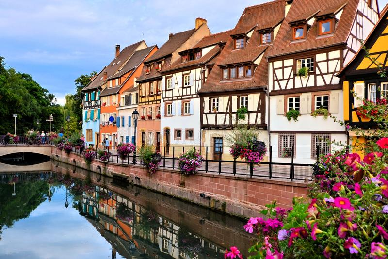 Canals of Colmar, France with reflections. Beautiful canals of Colmar, France with late day reflections stock photos