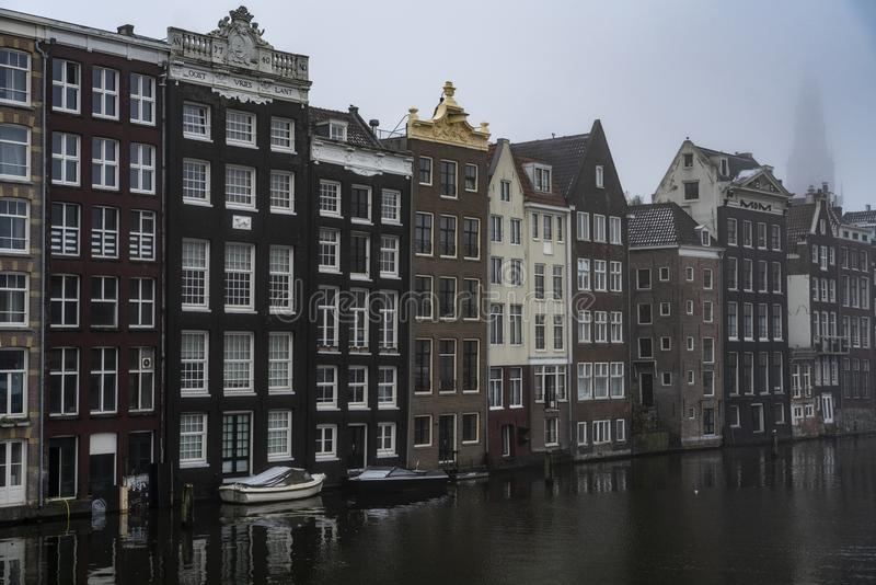 Canals and house of Amsterdam Holland. Amsterdam Holland The city of Amsterdam, capital of the Netherlands, is built on a network of artificial canals in Dutch stock photo