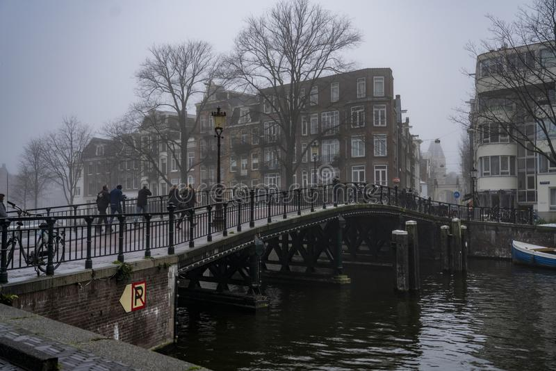 Canals and house and bridge of Amsterdam Holland. Amsterdam Holland The city of Amsterdam, capital of the Netherlands, is built on a network of artificial canals stock images