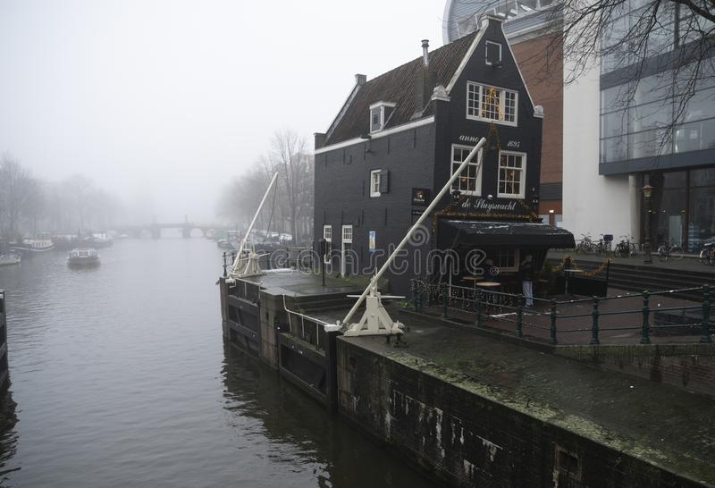 Canals and house and pub of Amsterdam Holland. Amsterdam Holland The city of Amsterdam, capital of the Netherlands, is built on a network of artificial canals in stock photography