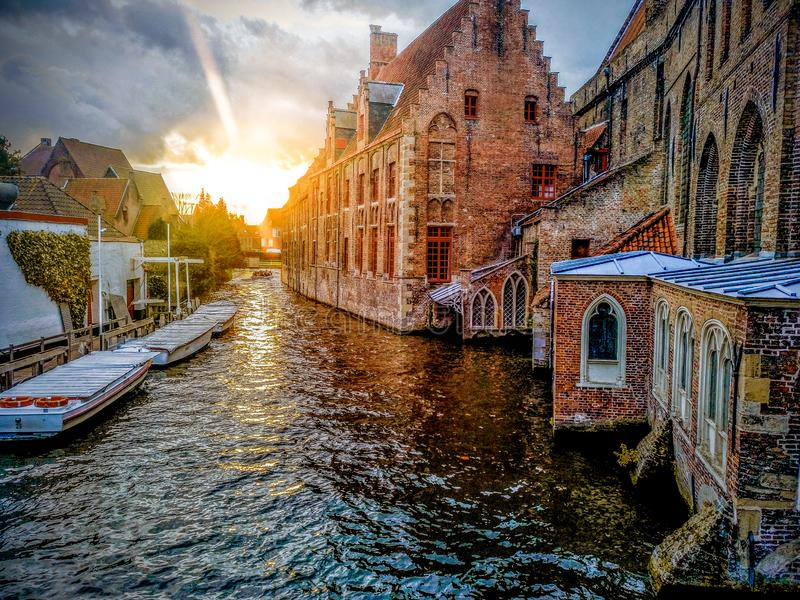 Canals of the medieval city of Brugge using the typical boats over canals in Belgium royalty free stock images