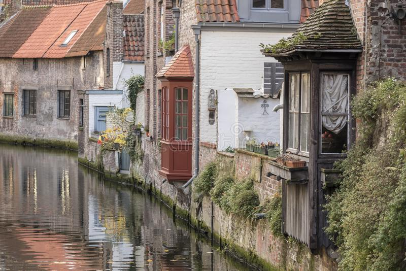 Canalside house bay windows Bruges. Bruges, the capital of West Flanders in northwest Belgium, is distinguished by its canals, cobbled streets and medieval royalty free stock photo