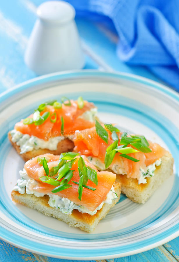 Canapé with salmon. Canape with salmon on plate royalty free stock photography