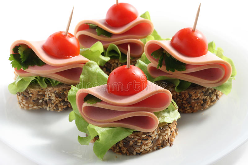 Canape with boiled sausage stock image
