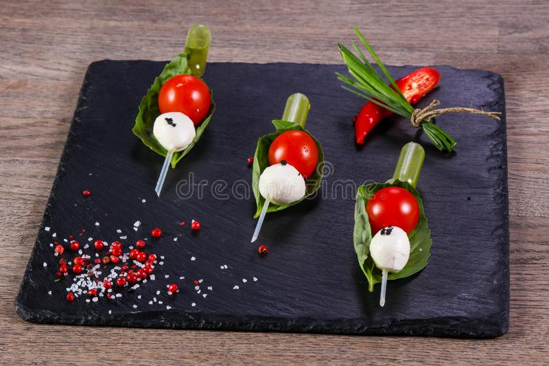Canape caprese with oil. Canape caprese with olive oil stock photo
