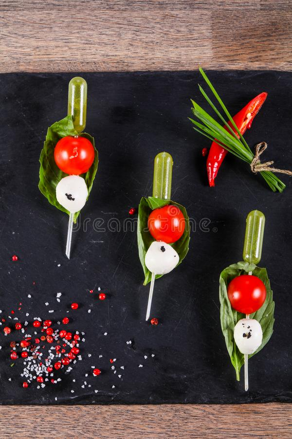 Canape caprese with oil. Canape caprese with olive oil royalty free stock photo