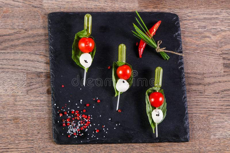 Canape caprese with oil. Canape caprese with olive oil stock photography