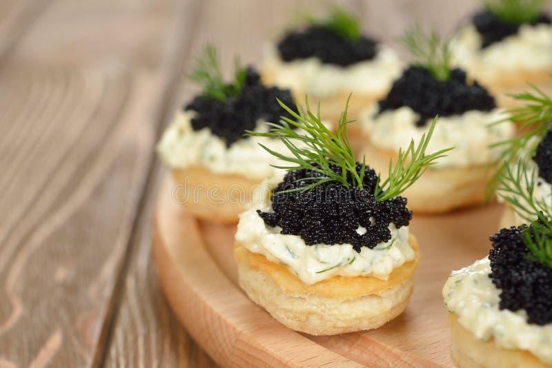 Canape with caviar royalty free stock photo