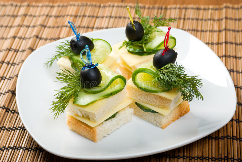 Download Canape With Cheese And Cucumber. Royalty Free Stock Photography - Image: 13921617