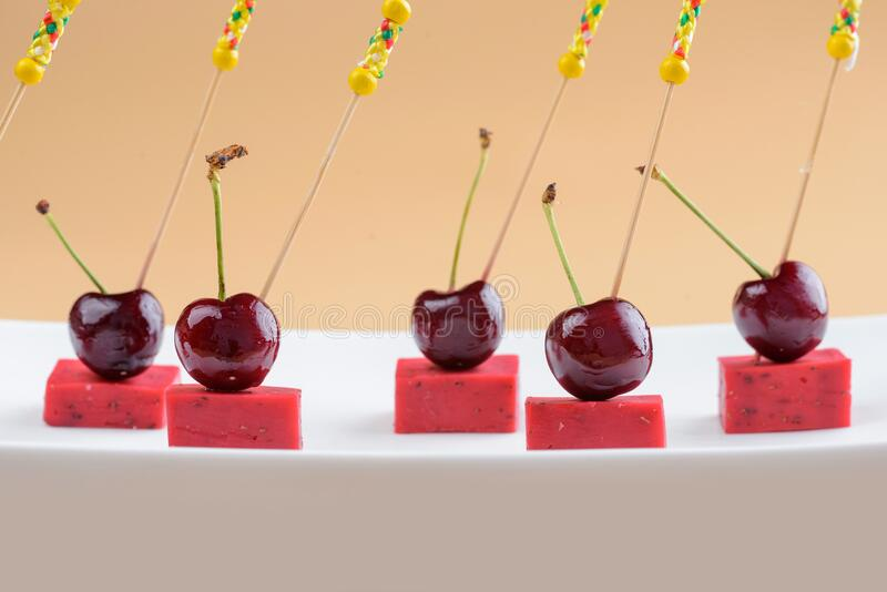 Canape with cherries and cheese royalty free stock images